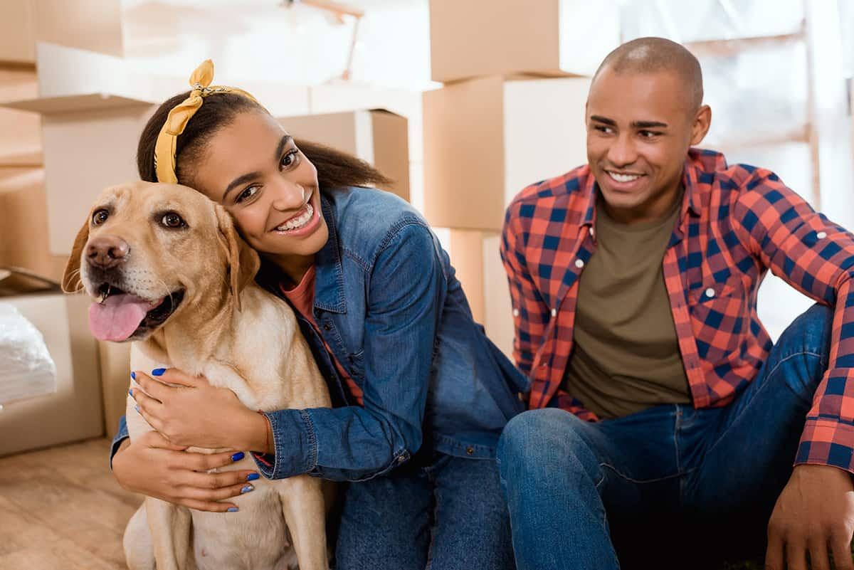 Happy African American Family Moving Into Home